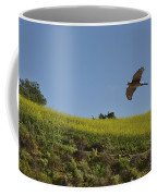Hawk Flying Over Field Of Yellow Mustard Coffee Mug