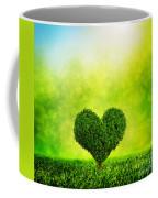 Heart Shaped Tree Growing On Green Grass Coffee Mug