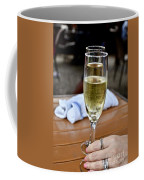 Holding Champagne Glass In Hand Coffee Mug