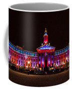 Holiday Light Panorama Of The Denver City And County Building Coffee Mug