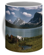 Horses Graze In A Lakeside Meadow Coffee Mug by Walter Meayers Edwards