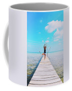 Hot Girl In White Jeans Doing Yoga On The Wooden Pier By The Sea Coffee Mug