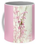 Hummingbird Perched Among Pink Blossoms Coffee Mug