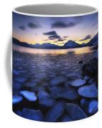 Ice Flakes Drifting Against The Sunset Coffee Mug by Arild Heitmann