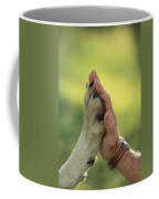 Jim Dutcher Places His Hand To The Paw Coffee Mug by Jim And Jamie Dutcher
