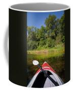 Kayak On A Forested Lake Coffee Mug