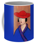 Lady In A Red Hat And Blue Coat Coffee Mug