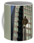 Lamp Post Against Green Glass Building Coffee Mug