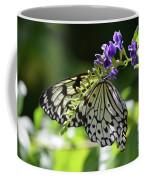 Large Tree Nymph Polinating Dainty Purple Flowers Coffee Mug