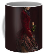 Late Victorian Woman In A Crimson Velvet Jacket And Dress Holdin Coffee Mug