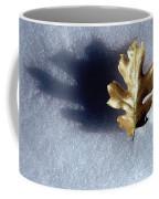 Leaf On Snow Coffee Mug