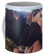 Legs Dangle Over The Cliff Looking Coffee Mug