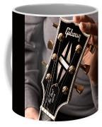Les Paul - Hands And Gibson Headstock By Gene Martin Coffee Mug