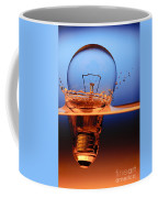 Light Bulb And Splash Water Coffee Mug by Setsiri Silapasuwanchai