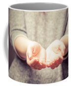 Light In Young Woman's Hands Coffee Mug