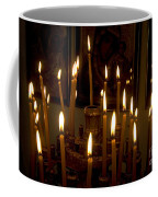 lit Candles in church  Coffee Mug