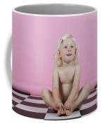 Little Girl Sits On A Checkered Floor Coffee Mug