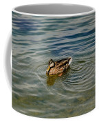 Lone Duck Swimming On A River Coffee Mug by Todd Gipstein