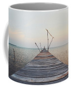 Long, Empty And Old Wooden Dock Over The Water At Sunset Coffee Mug