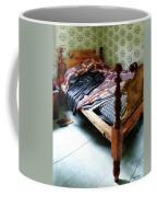 Long Sleeved Dress On Bed Coffee Mug
