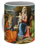 Madonna And Child With A Goldfinch With Saints Catherine And Paul Before An Extensive Landscape Coffee Mug