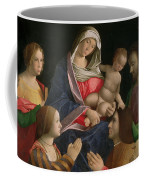 Madonna And Child With Saint John The Baptist Two Saints And Donors Coffee Mug
