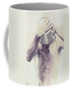 Man Pouring Cold Water From Wine Cooler Over Body Coffee Mug by Jorgo Photography - Wall Art Gallery