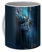Man With Keys At Door Coffee Mug