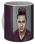 Man With Modern Bun Hairstyle In Black Shirt Coffee Mug