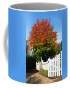 Maple And Picket Fence Coffee Mug by Olivier Le Queinec