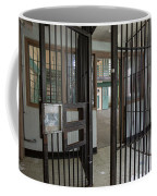 Metal Bars Leading Into Cellblock In Prison Coffee Mug