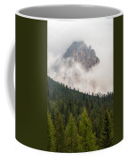 Mighty Dolomite Peaking Through The Clouds Coffee Mug