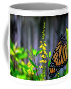 Monarch Butterfly Poised On Green Stem Among Yellow Flowers Coffee Mug