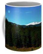 Moon Setting Into The Rocky Mountains Coffee Mug