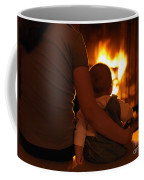 Mother And Son Sitting In Front Of A Firepalce Coffee Mug