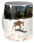Mountain Goat Crossing A Snow Patch Coffee Mug