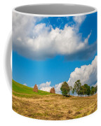 Mountain Landscape With Haystacks And Trees On Top Of Hill Coffee Mug