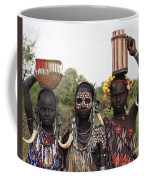 Mursi Tribesmen In Ethiopia Coffee Mug