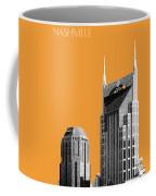 Nashville Skyline At And T Batman Building - Orange Coffee Mug