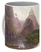 Native Figures In A Canoe At Milford Sound Coffee Mug