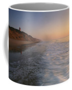 Nauset Light On The Shoreline Of Nauset Coffee Mug by Michael Melford