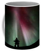 Northern Lights Above An Inukchuk In Saskatchewan Coffee Mug