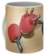 Number Of Ping Pong Bats Piled On A Table Coffee Mug