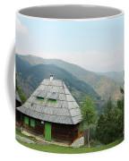 Old Log Cabin On Mountain Landscape Coffee Mug
