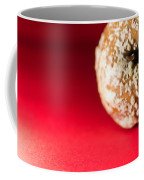 Old Rotting Apple With Fruit-rot On Red Background Coffee Mug
