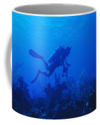 One Man Scuba Diving On Coral Reef Coffee Mug
