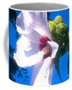 Open Hibiscus Flower With Deep Blue Sky Coffee Mug