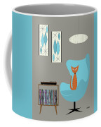 Orange Cat In Turquoise Egg Chair Coffee Mug