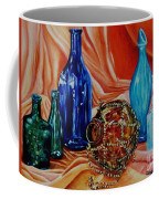 Orange Cloth Blue Bottles Coffee Mug