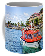 Orange Lifeboats Across Colorful Bay Coffee Mug